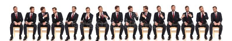 Grupo grande del mismo hombre de negocios con diversas reacciones fotografía de archivo