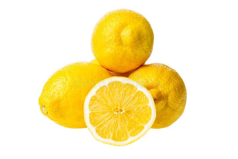 Grupo maduro amarelo dos limões isolado no fundo branco imagem de stock