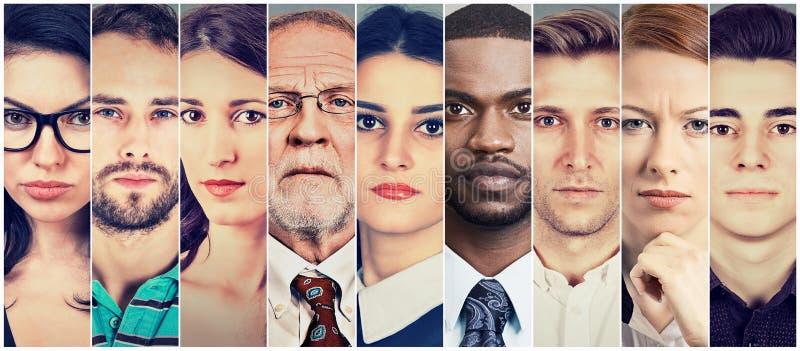 Grupo multiétnico de gente seria imagen de archivo