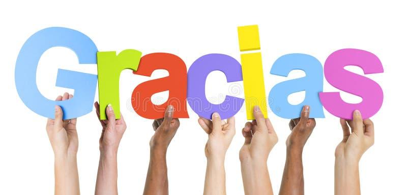 Grupo multiétnico de manos que sostienen Gracias imágenes de archivo libres de regalías