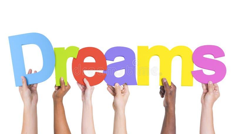 Grupo multi-étnico de mãos que guardam sonhos foto de stock royalty free