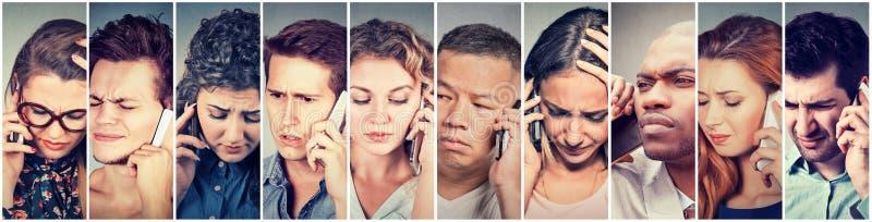 Grupo multicultural de hombres tristes y de mujeres de la gente que hablan en el teléfono móvil foto de archivo libre de regalías