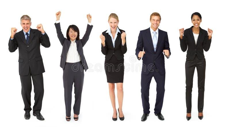 Grupo triunfante de homens de negócios e de mulheres fotos de stock