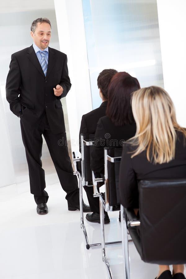Grupp av affärsfolk på föreläsningen arkivfoto