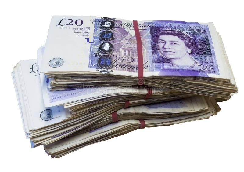Grupp av använt UK 20 tjugo pundanmärkningar royaltyfri foto