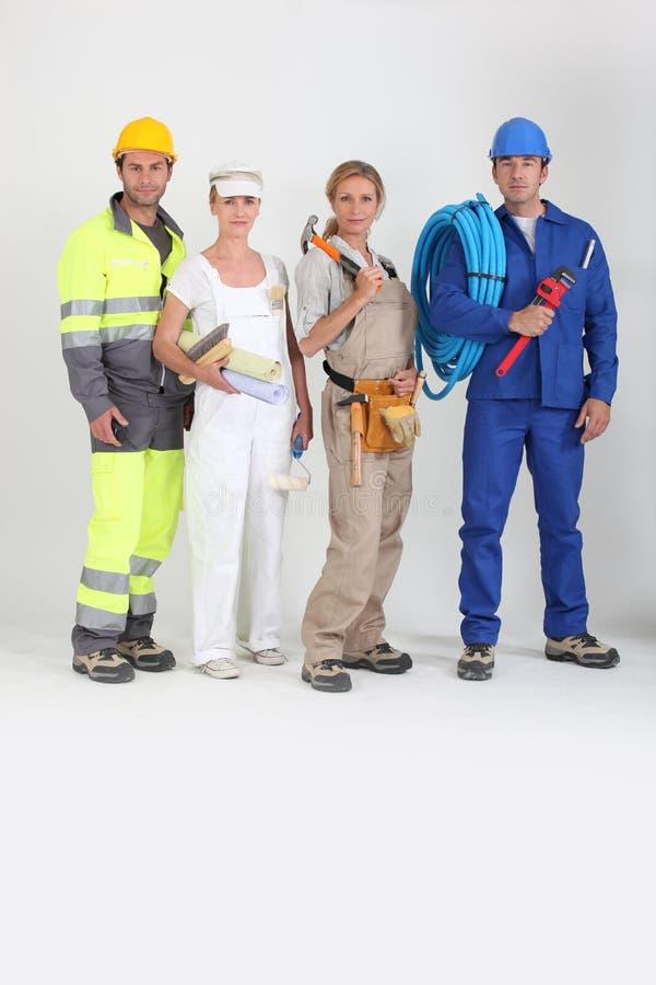 Grupp av arbetare arkivbilder
