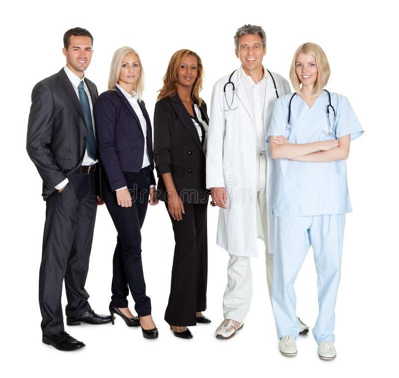 Grupp av arbetare på vit bakgrund royaltyfria bilder