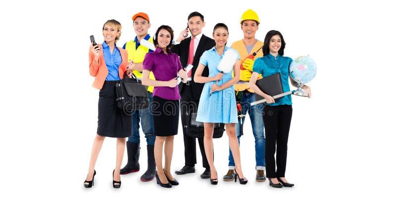 Grupp av asiatiska män och kvinnor med olika yrken royaltyfria foton