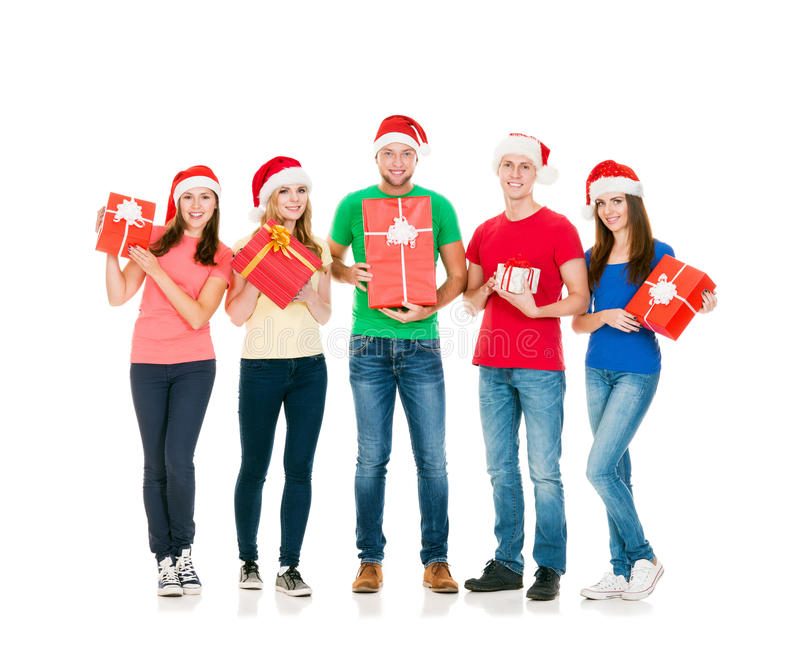 Grupp av att le vänner i julhattar royaltyfri fotografi