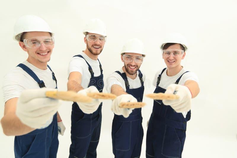 Grupp av byggnadsarbetare Isolerat på vit arkivbilder