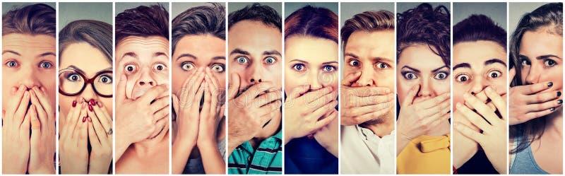 Grupp av chockat folk som täcker deras mun med händer royaltyfri foto