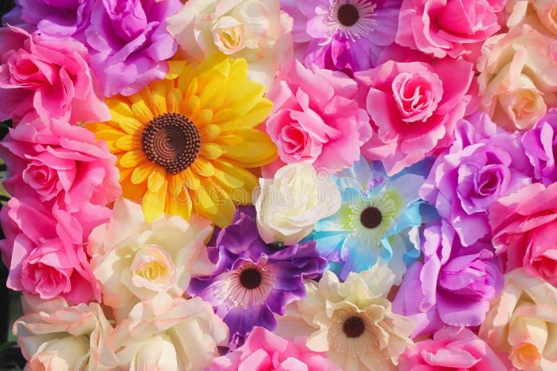 Grupp av dekorativ färgrik härlig konstgjord muticolored abstrakt textur för blommamodeller för bakgrund fotografering för bildbyråer