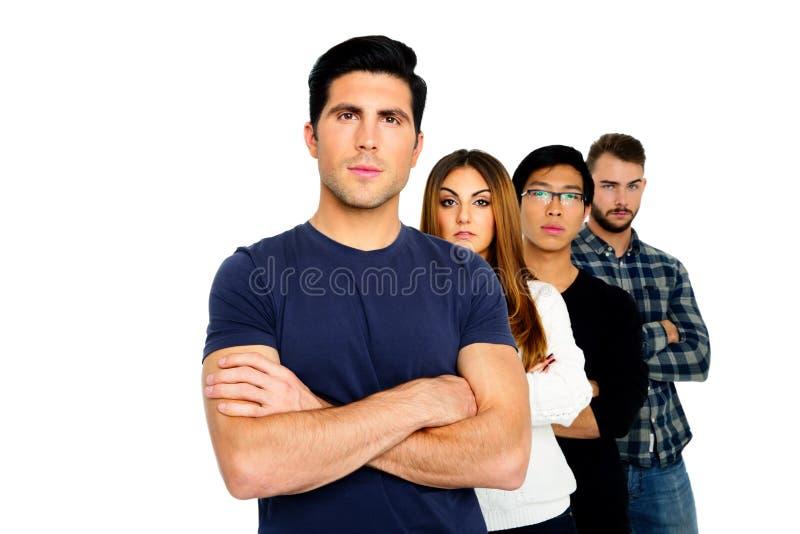 Grupp av ett folk som i rad står royaltyfri foto