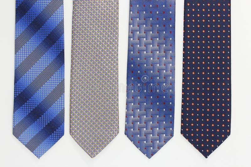 Grupp av färgrika slipsar på vit royaltyfria bilder