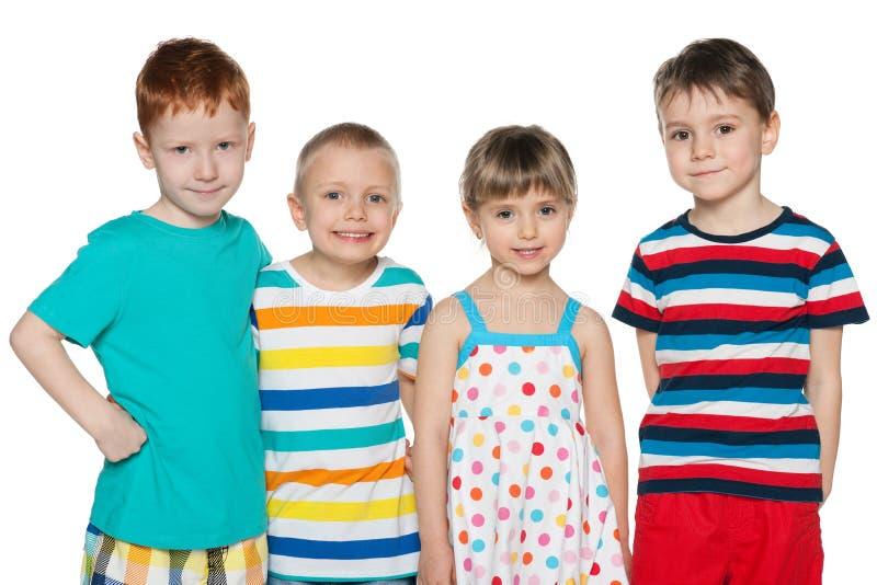 Grupp av fyra glade barn royaltyfri bild