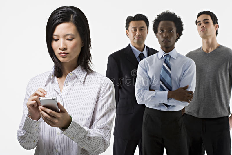 Grupp av fyra kontorsarbetare royaltyfri foto