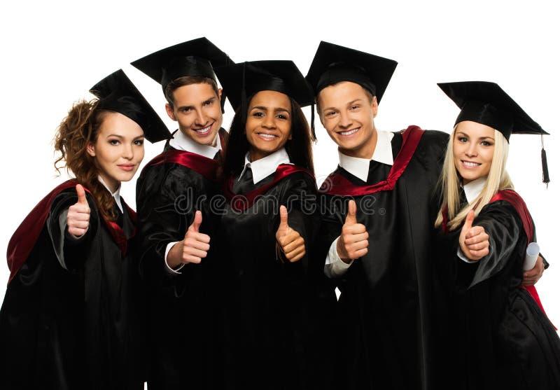 Grupp av graderade unga studenter royaltyfria foton