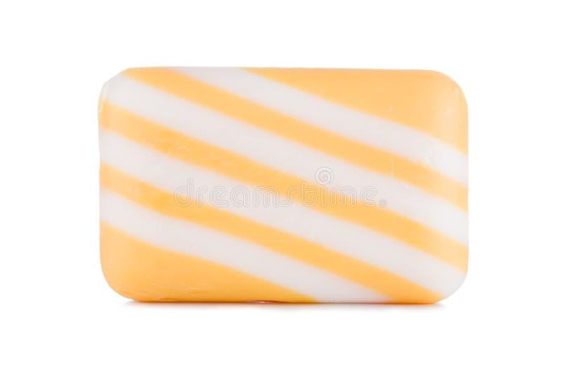 Grupp av gula mång- kulöra randiga tvålar på vit bakgrund arkivfoto