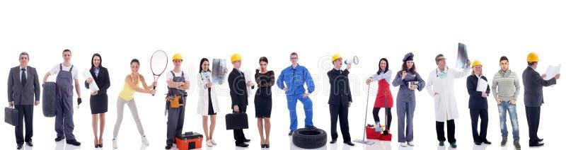 Grupp av industriarbetare bakgrund isolerad white arkivbild