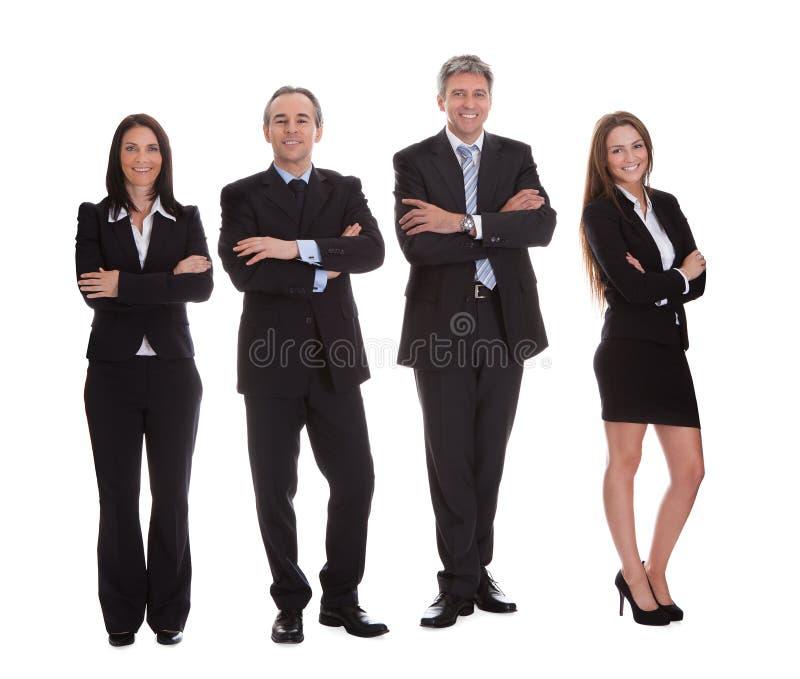 Grupp av lyckliga businesspeople fotografering för bildbyråer
