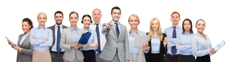 Grupp av lyckligt affärsfolk som pekar på dig royaltyfria bilder