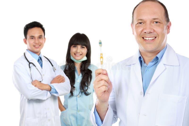 Grupp av medicinska arbetare tandläkare royaltyfria bilder