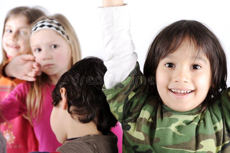 Grupp av skämtsamma barn royaltyfria bilder