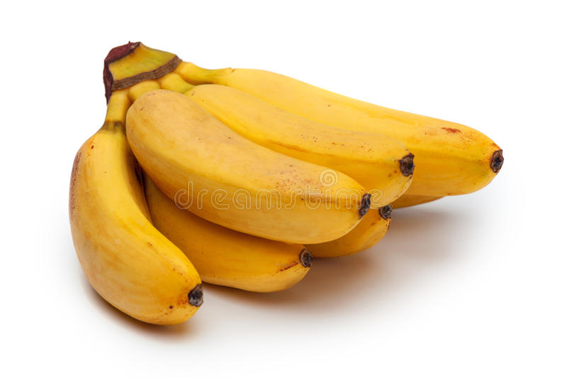 Grupp av små bananer som isoleras på vit royaltyfri fotografi