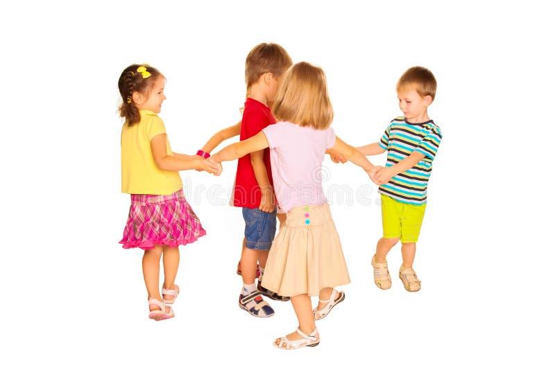 Grupp av små barn som dansar och att ha gyckel royaltyfria foton