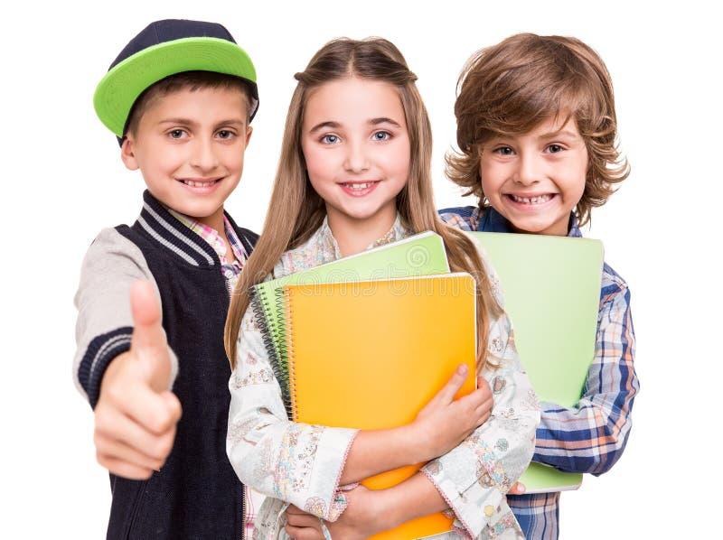 Grupp av små studenter royaltyfria bilder