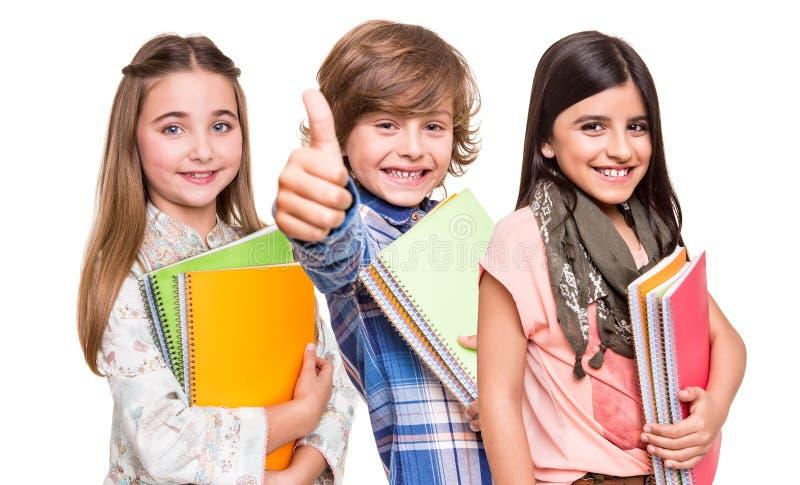 Grupp av små studenter royaltyfria foton