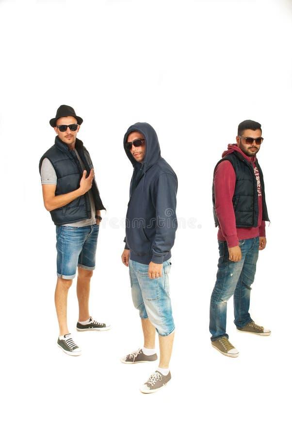 Grupp av tre rapparemän fotografering för bildbyråer