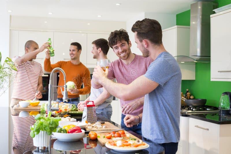 Grupp av vänner som gör mat royaltyfria foton