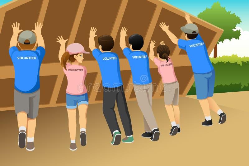 Grupp av volontärer som tillsammans bygger en illustration för hus stock illustrationer