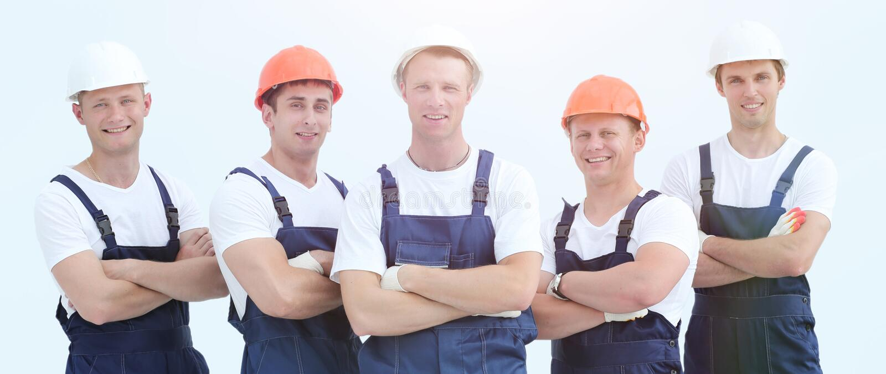 Grupp av yrkesmässiga industriarbetare royaltyfria foton