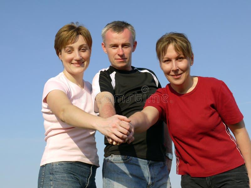 grupp lyckade tre fotografering för bildbyråer