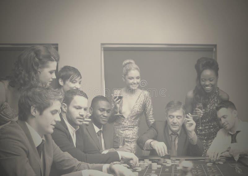 Grupp människor i kasino royaltyfri fotografi