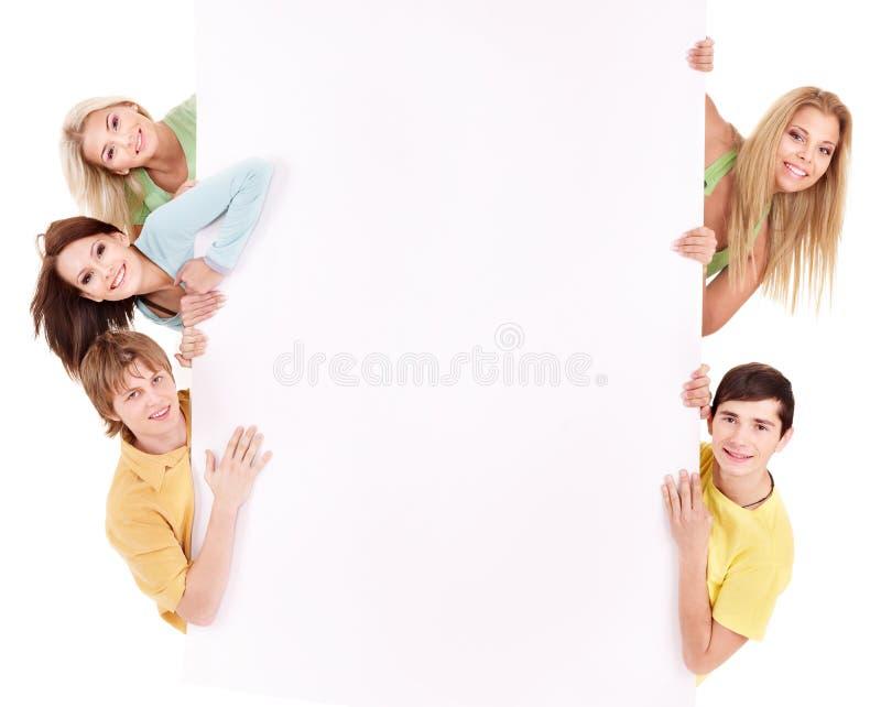 Gruppe der glücklichen Leuteholdingfahne. lizenzfreies stockfoto