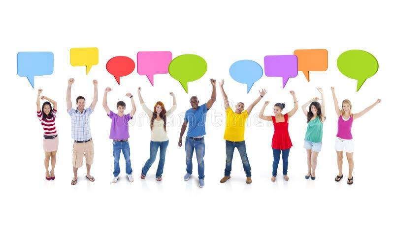 Gruppe des Studenten Speech Bubbles Discussion stockbild