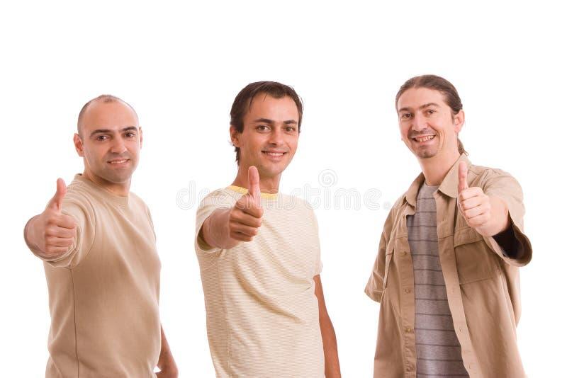 Gruppe Freunde, die sich Daumen zeigen lizenzfreie stockfotos