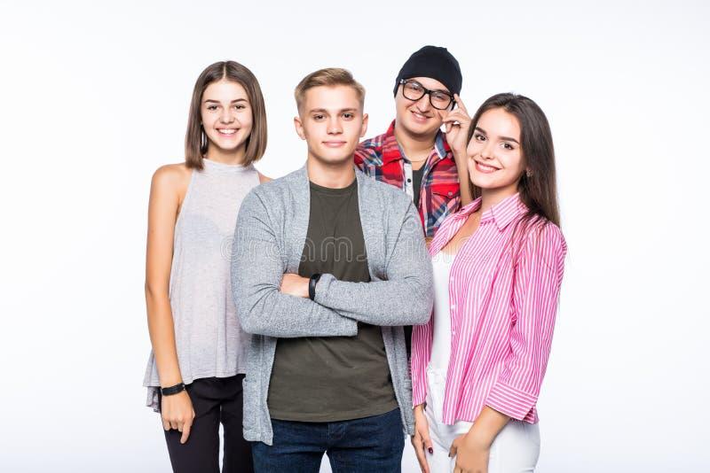 Gruppe glückliche junge Leute lokalisiert auf weißem Hintergrund stockbilder