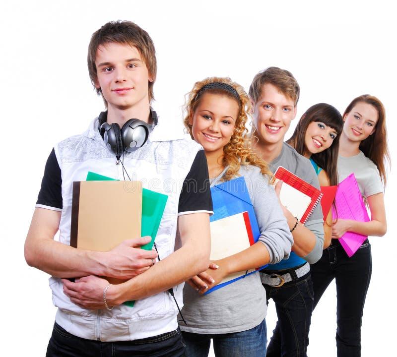Gruppe junge lächelnde Kursteilnehmer stockbild