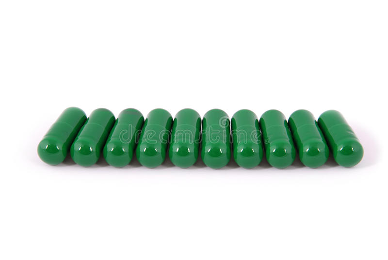Gruppe Kapselpillen mit grüner Farbe lizenzfreie stockfotos
