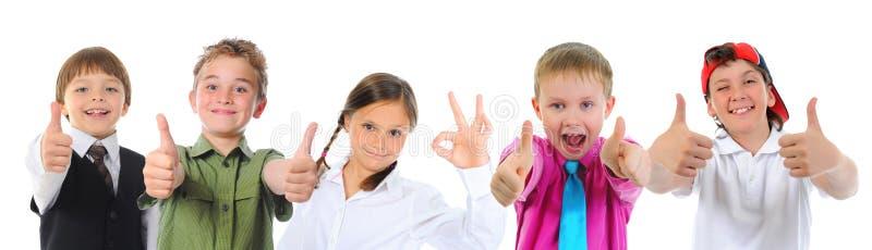 Gruppe Kinderaufstellung lizenzfreie stockfotos