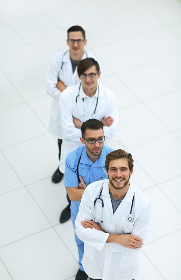 Gruppe medizinisches Personal Lokalisiert auf Weiß lizenzfreie stockfotografie