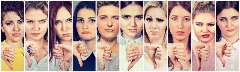 Gruppe multikulturelle junge Frauen, die Daumen gestikulieren herstellen unten, für Widerspruch lizenzfreie stockfotografie
