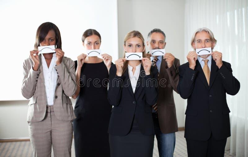 Gruppe Unternehmensleiter mit traurigen Gefühlen lizenzfreies stockbild