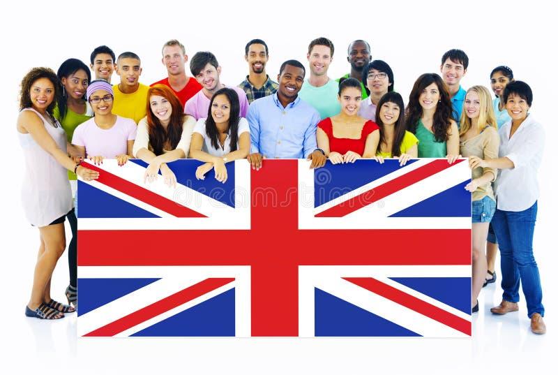 Gruppe von Personen, die Brett Vereinigten Königreichs hält lizenzfreie stockbilder