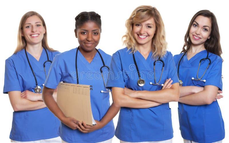 Gruppe von vier Krankenschwestern stockfotos