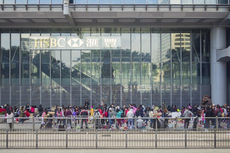 Gruppen ausländische Arbeiter auf Straße stockfotografie